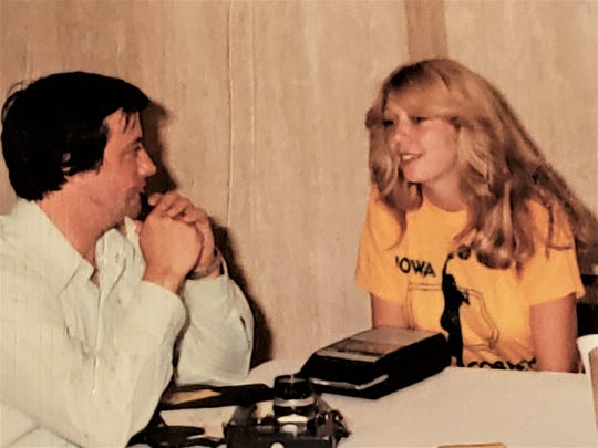 Molly (Van Benthuysen) Bolin takes questions from a reporter before an Iowa Cornets game.