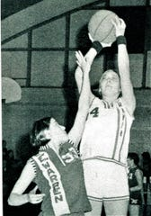 Molly Van Benthuysen shoots a jumper over a Southeast Warren player while playing for Moravia as an Iowa prep.