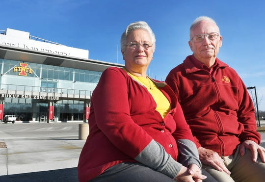 Bill and Judy Hoefle pose in front of South End Zone at Jack Trice Stadium Sunday, Dec. 21, 2019, in Ames, Iowa. A Hoefle has been to each Iowa State bowl game since the 1971 Sun Bowl.