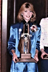 Molly (Van Benthuysen) Bolin is inducted into the Iowa Girls Athletic Union Hall of Fame in 1986.