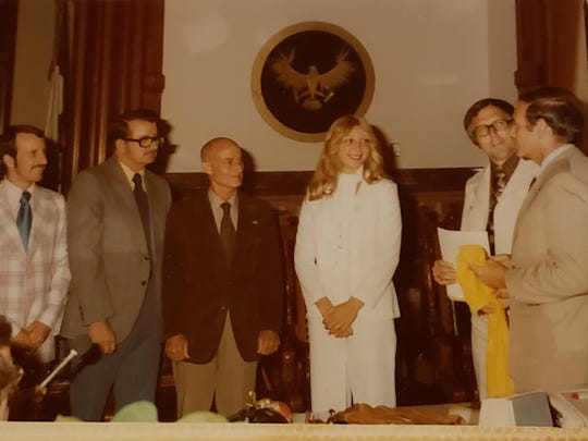 Molly (Van Benthuysen) Bolin became the first woman to sign a contract with a U.S. women's professional basketball league. At the far right is then-Gov. Bob Ray.