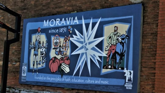 A mural in Moravia contains an image of Molly (Van Benthuysen) Bowlin as a prep.