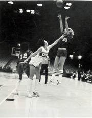 Molly Bolin of the Iowa Cornets goes for a shot against the Wisconsin Does in a WBL game.
