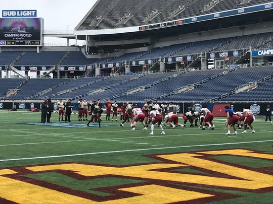 Iowa State players run through practice at the Camping World Stadium in Orlando, Florida.