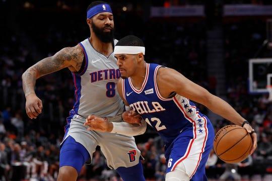 Philadelphia 76ers forward Tobias Harris (12) drives on Detroit Pistons forward Markieff Morris (8) during the first half of an NBA basketball game Monday, Dec. 23, 2019, in Detroit. (AP Photo/Carlos Osorio)