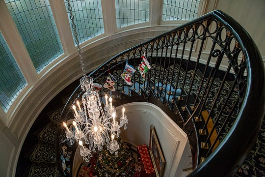 This Grosse Pointe home built for a member of the Stroh brewing family in 1919 welcomes you with a grand foyer spiral staircase and marble flooring, crystal chandelier and leaded glass windows.