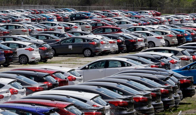 Ford Focus vehicles are seen on a storage lot on Friday, May 1, 2015 in Ypsilanti.