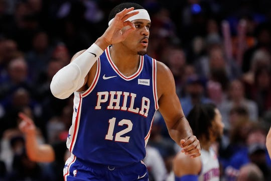76ers forward Tobias Harris celebrates a 3-point basket in the first half of the Pistons' 125-109 loss on Monday, Dec. 23, 2019, at Little Caesars Arena.