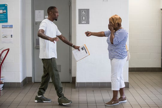 James Chad-Lewis Clay, left, walks to hug his mother Ethel Marie Lyons after being released from the Macomb Correctional Facility in Lenox in July.