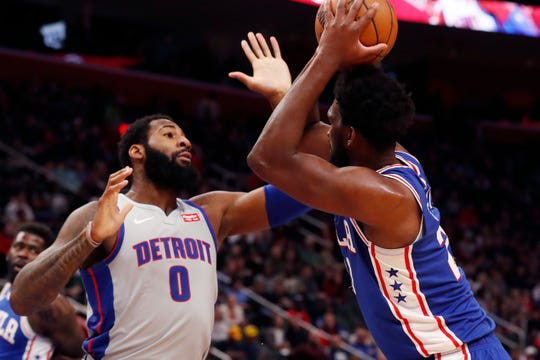 Philadelphia 76ers center Joel Embiid, right, is defended by Detroit Pistons center Andre Drummond (0) during the first half of an NBA basketball game, Monday, Dec. 23, 2019, in Detroit. (AP Photo/Carlos Osorio)