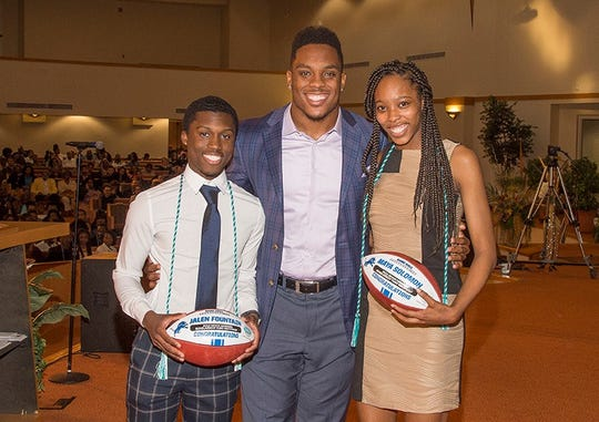 Lions linebacker Devon Kennard awards two scholarships at the Midnight Golf graduation ceremony on Wednesday, May 9, 2019, in Detroit.