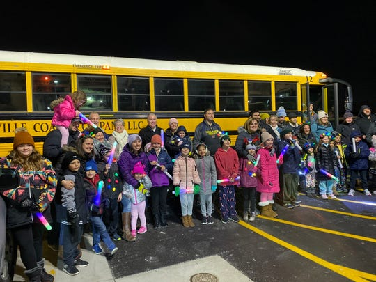 Koslowski family takes bus with friends and community members to celebrate 'Moonbeams for Sweet Dreams' at Beaumont in Royal Oak.
