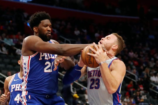 76ers center Joel Embiid fouls Pistons forward Blake Griffin during the second half of the Pistons' 125-109 loss on Monday, Dec. 23, 2019, at Little Caesars Arena.