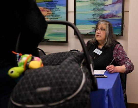 """Program coordinator Julie Grodin checks in a guest preparing dinner during """"Shelter Week"""" at Congregation Beth Shalom in Oak Park."""