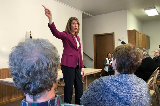 In this Saturday, Dec. 21, 2019, photo, Rep. Cindy Axne, D-Iowa., speaks to constituents about her vote on the USMCA trade deal in Guthrie Center, Iowa.