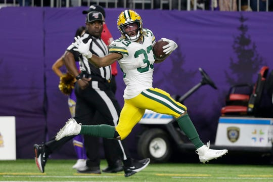 Packers running back Aaron Jones runs for a 56-yard touchdown during the second half on Monday.