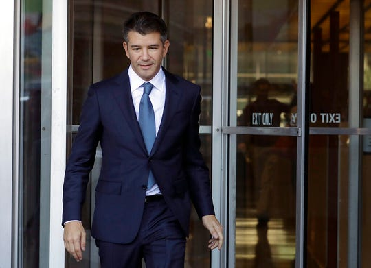 In this Feb. 7, 2018, file photo, former Uber CEO Travis Kalanick leaves federal court in San Francisco. Former Uber CEO Kalanick will resign from the company's board next week, effectively severing ties with the company he co-founded a decade ago.
