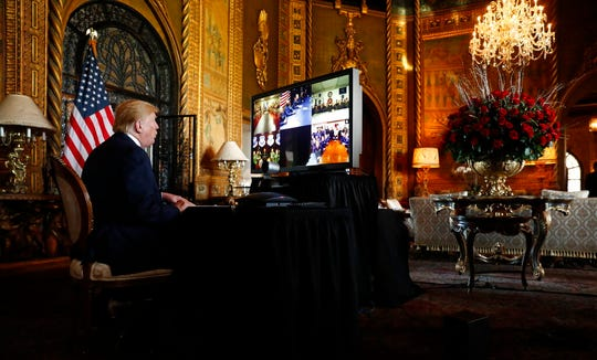 President Donald Trump speaks during a Christmas Eve video teleconference with members of the military at his Mar-a-Lago estate in Palm Beach, Fla., Tuesday, Dec. 24, 2019.