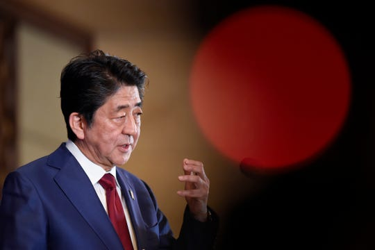 Japan's Prime Minister Shinzo Abe answers a question at a press conference at the 8th trilateral leaders' meeting between China, South Korea and Japan in Chengdu, in southwest China's Sichuan province on Tuesday, Dec. 24, 2019.