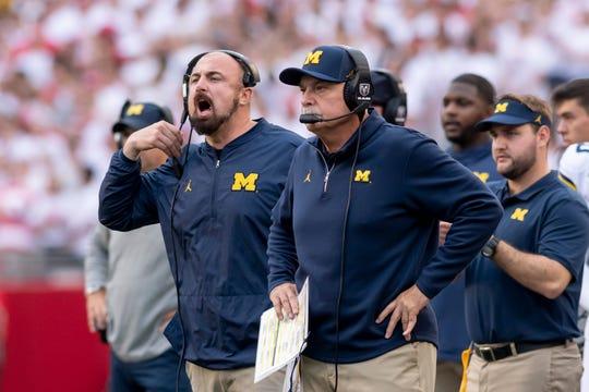 Under defensive coordinator Don Brown, right, Michigan's defense ranks No. 7 in the nation.