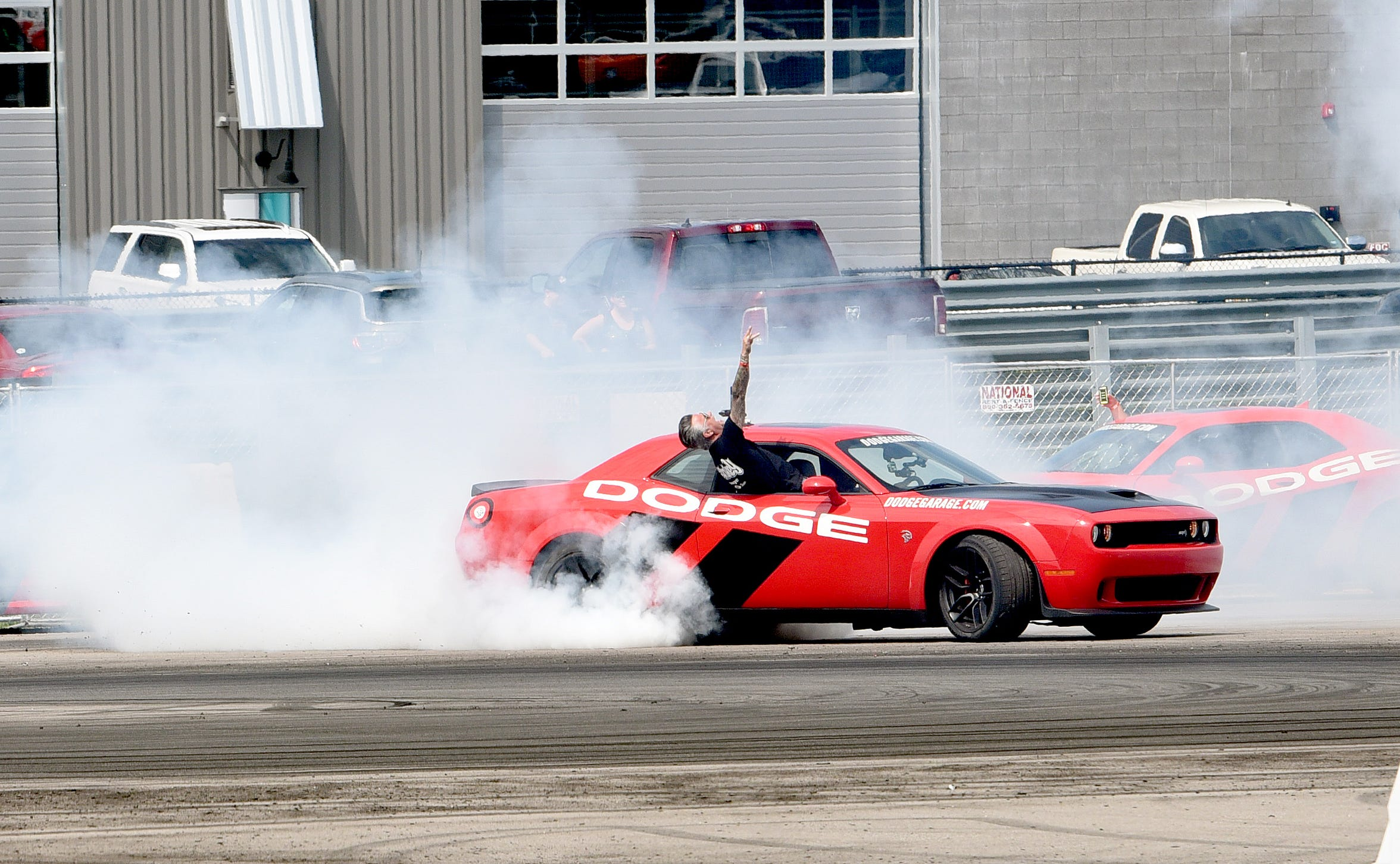 Dodge Challenger Hellcat performs a burnout