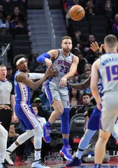 Pistons forward Blake Griffin (23) passes the ball under pressure by 76ers guard Josh Richardson (0) during Monday's game.