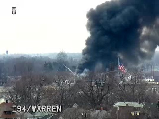 A Michigan Department of Transportation freeway camera shows black smoke coming from a grocery store fire in Detroit.