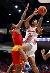 Dayton guard Ibi Watson (2) puts up a shot against Grambling State guard Kelton Edwards, left, during the first half on Monday.