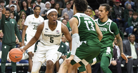 Michigan State guard Cassius Winston, left, drives along the baseline against Eastern Michigan at the Breslin Center in East Lansing.