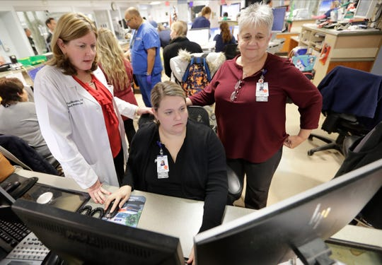 Kathleen Sheehan, left, director of Emergency and Trauma Services, speaks with Sarah Horn, center, and Lead Case Manager Jeanne Icolari Dec. 19, 2019, in the Emergency room at St. Luke's Cornwall Hospital in Newburgh, N.Y.