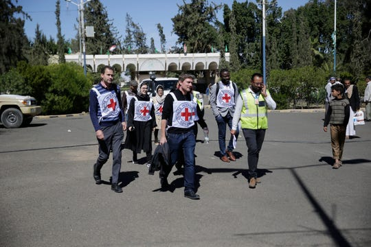 Members of the International Committee of the Red Cross (ICRC) arrive at Sanaa Airport to receive Houthi prisoners after being released by the Saudi-led coalition, Yemen, Thursday, Nov. 28, 2019.