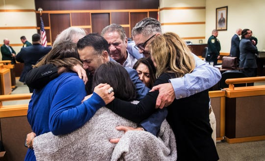 Family and friends of Teresa Sievers embrace after Mark Sievers was found guilty in the murder of his wife, Dr. Teresa Sievers on Wednesday Dec, 4, 2019. The jury recommended the death penalty days later.