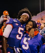 Clemson receiver Tee Higgins embraces his mother, Camillia Stewart