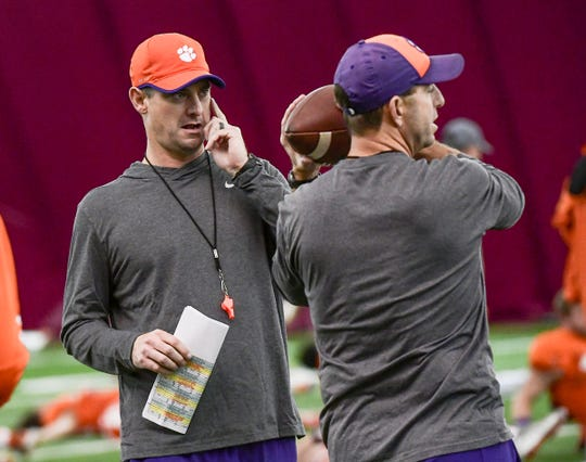 Clemson wide receiver coach Jeff Scott, left, talks with Head Coach Dabo Swinney during practice in Tempe, Arizona Tuesday, December 24.