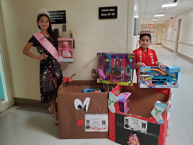 Leah's Fabulous Productions Little Mister Guam 2019 James Taga II and Miss Pre Teen Guam 2019 Breanna Chovich delivered toys to the kids at GMH Pediatric Ward on Dec. 22.