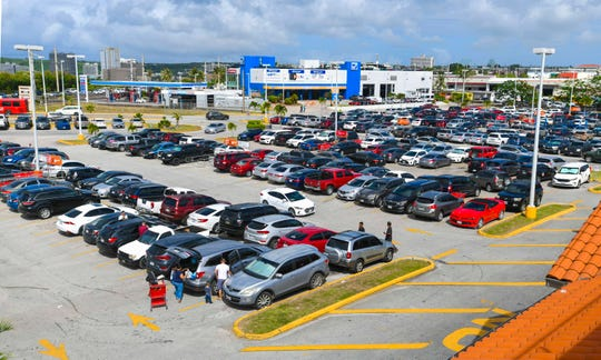 Cars fill the parking lot of the Kmart store in Tamuning during the last day of shopping before Christmas on Tueday, Dec. 24, 2019.