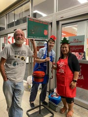Salvation Army Guam Corps volunteers stand outside of Kmart for the organization's annual holiday bell ringer campaign.