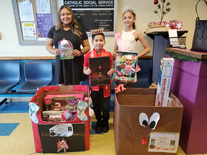 Little Mister Guam 2019 James Taga II and Miss Pre Teen Guam 2019 Breanna Chovich delivered toys for the Children at The Alee Shelter. Benalyn Naputi Alee social worker was present to receive.