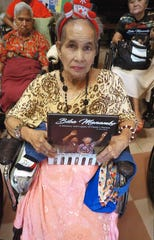 Forty copies of the book Biba Manamko were given to the clients and staff of St. Dominic's Senior Care Home by photographer, writer, Don Seery. Pictured: Carmela Babauta