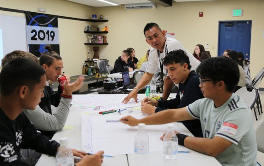 Jack Kido, in white, listens in a group discussion during the 2019 Year-End Referees Seminar held Saturday at the Guam Football Association National Training Center Lecture Hall.