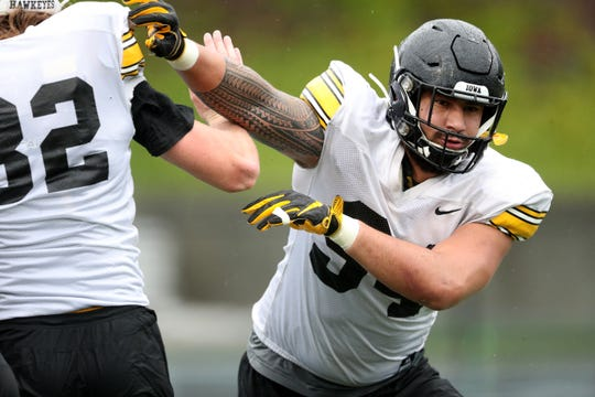 Iowa defensive end A.J. Epenesa (94) operates during a practice drill Monday in San Diego.