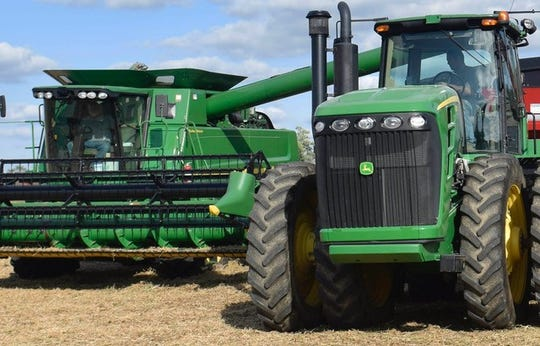 Jeff Deck, left, and his son Daniel Deck, right, combine soybeans on the family farm. In the field, they communicate by phone. Technology has changed tremendously since Jeff Deck began farming as a boy.