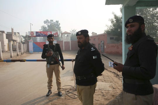 Pakistani police officers stand guard outside Multan jail in Multan, Pakistan, Saturday, Dec. 21, 2019. A Pakistani court on convicted Muslim professor Junaid Hafeez of blasphemy, sentencing him to death for allegedly spreading anti-Islamic ideas. Hafeez in 2009 attended Jackson State University in Jackson, Miss., as a Fulbright scholar.