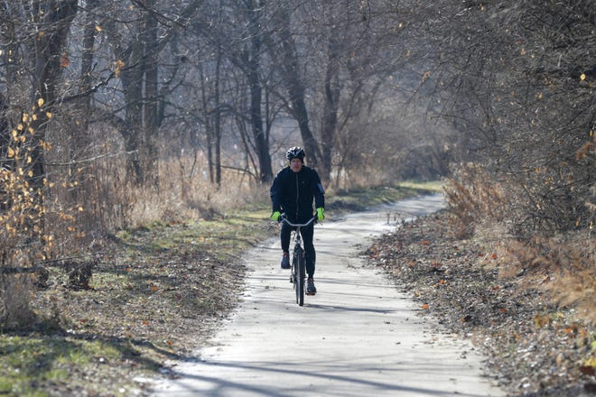 A cyclist rides along the Wabash Heritage Trail near McAllister Park, Tuesday, Dec. 24, 2019 in Lafayette.