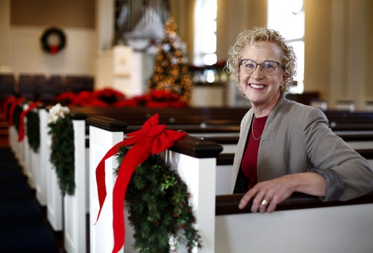 Rev. Dr. Julia Wharff Piermont (CQ) poses for a portrait at Worthington Presbyterian Church, 773 High St in Worthington, on Monday, December 23, 2019. The church will be wiping out medical debts of every eligible person in Franklin County by buying off debt from collection agencies. [Fred Squillante/Dispatch]