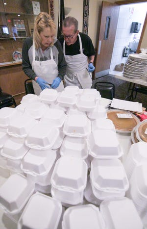 Meals on Wheels volunteer Mary Wojdyla talks to American Legion Devereaux Post 141 chef Tom Stone Tuesday, Dec. 24, 2019 as Wojdyla packages pumpkin pies to be delivered to seniors on Christmas.