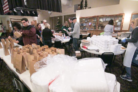 Meals on Wheels volunteers and staff package meals Tuesday, Dec. 24, 2019 at the American Legion Devereaux Post 141 to be delivered on Christmas Day.
