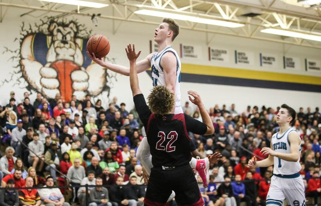 North Oldham's  Justin Powell, who earned the tournament's Bob White MVP award, had 22 points and 10 rebounds against Ballard in the Kings of the Bluegrass championship game Monday night at Fairdale High School. Powell is an Auburn signee. Dec. 23, 2019