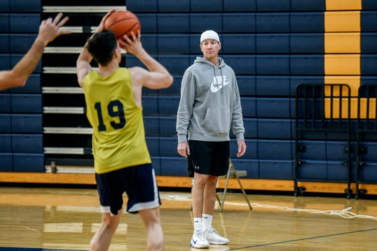 Comets assistant basketball coach Todd Hastings, right, watches as players run drills during practice on Monday, Dec. 23, 2019, at Grand Ledge High School. Friends and community members are raising money to support the Hastings family and their three young children, while Todd is treated for cancer.