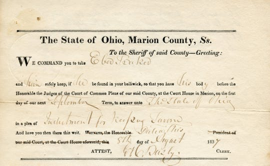 The arrest warrant for Eber Baker. Baker eventually owned a proper hotel and tavern when he built the Mansion House Hotel.